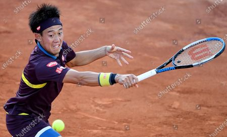 Kei Nishikori of Japan in action against Alexander Zverev of Germany during their men's singles third round match at the Italian Open tennis tournament in Rome, Italy, 13 May 2021.