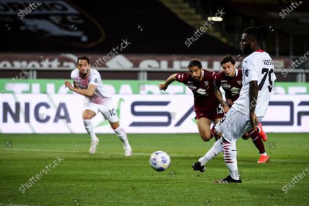 Milan midfielder Franck Kessie (79) scores his goal to make it 0-2 from a penalty kick during the Serie A football match n.36 TORINO - MILAN on May 12, 2021 at the Stadio Olimpico Grande Torino in Turin, Piedmont, Italy. Final result: Torino-Milan 0-7. Sporting stadiums around Italy remain under strict restrictions due to the Coronavirus Pandemic as Government social distancing laws prohibit fans inside venues resulting in games being played behind closed doors.