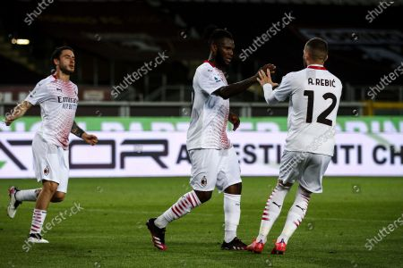 Milan midfielder Franck Kessie (79) celebrates with Milan forward Ante Rebic (12) after scoring his goal to make it 0-2 during the Serie A football match n.36 TORINO - MILAN on May 12, 2021 at the Stadio Olimpico Grande Torino in Turin, Piedmont, Italy. Final result: Torino-Milan 0-7. Sporting stadiums around Italy remain under strict restrictions due to the Coronavirus Pandemic as Government social distancing laws prohibit fans inside venues resulting in games being played behind closed doors.