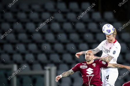 Milan defender Simon Kjaer (24) and Torino forward Simone Zaza (11) head the ball during the Serie A football match n.36 TORINO - MILAN on May 12, 2021 at the Stadio Olimpico Grande Torino in Turin, Piedmont, Italy. Final result: Torino-Milan 0-7. Sporting stadiums around Italy remain under strict restrictions due to the Coronavirus Pandemic as Government social distancing laws prohibit fans inside venues resulting in games being played behind closed doors.