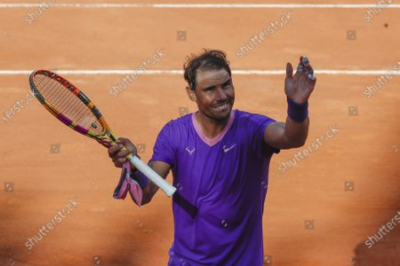 Spain's Rafael Nadal celebrates after beating Canada's Denis Shapovalov, in their 3rd round match at the Italian Open tennis tournament, in Rome, . Nadal won 6-3, 4-6, 6-7