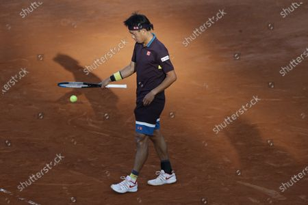 Stock Picture of Kei Nishikori of Japan prepares to serve to Alexander Zverev of Germany during their 3rd round match at the Italian Open tennis tournament, in Rome