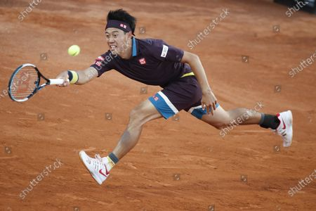 Kei Nishikori of Japan returns the ball to Alexander Zverev of Germany during their 3rd round match at the Italian Open tennis tournament, in Rome
