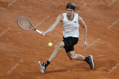 Stock Photo of Alexander Zverev of Germany returns the ball to Kei Nishikori of Japan during their 3rd round match at the Italian Open tennis tournament, in Rome