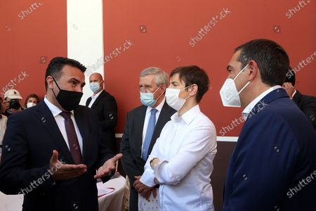 Greek leader of main opposition SYRIZA party, Alexis Tsipras (R) speaks with Prime Minister of North Macedonia Zoran Zaev (L) and Prime Minister of Serbia Ana Brnabic (R2) as he arrives at the Zappeion Megaron where the 6th Delphi Economic Forum is taking place, Athens, Greece, 13 May 2021. More than 1,000 guest speakers from 42 countries will take part in the discussions held at the forum, which are divided into 10 broad themes, either attending physically at specially equipped studios at Zappion or online. The 10 main themes during the forum are the bicentennial since the Greek Revolution 1821-2021, Geopolitics and International Security, Global Economy, the Future of Europe, Sustainability and Climate Change, People, Organisations and Society, Technology and the Future of Growth, Greece: Structural Reforms and Sustainable Development, Health, Education.