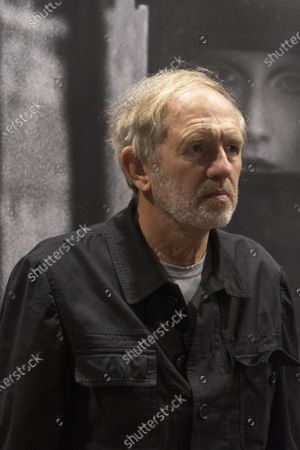Stock Image of Exhibition dedicated to Peter Lindbergh in the ARTiglieria Con/temporary Art Center in Turin. Anton Corbijn artist and friend of Peter during the presentation