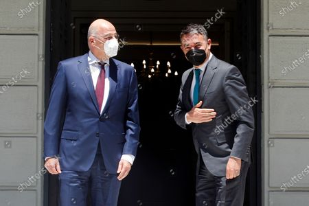 Stock Image of Greek Foreign Minister Nikos Dendias (L) welcomes Minister of Foreign Affairs of North Macedonia Nikola Dimitrov (R), during their meeting in Athens, Greece, 13 May 2021. Nikola Dimitrov is in Athens on a working visit.