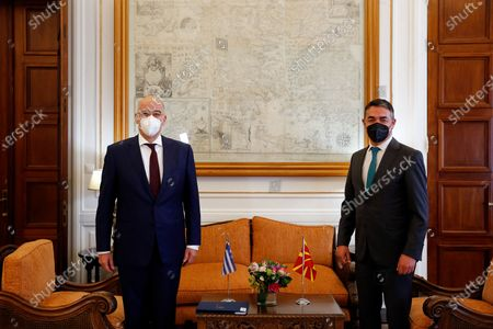 Stock Picture of Greek Foreign Minister Nikos Dendias (L) talks with Minister of Foreign Affairs of North Macedonia Nikola Dimitrov (R), during their meeting in Athens, Greece, 13 May 2021. Nikola Dimitrov is in Athens on a working visit.
