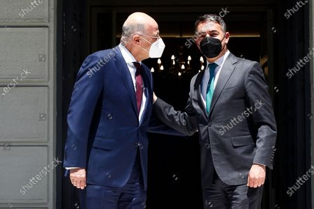 Greek Foreign Minister Nikos Dendias (L) welcomes Minister of Foreign Affairs of North Macedonia Nikola Dimitrov (R), during their meeting in Athens, Greece, 13 May 2021. Nikola Dimitrov is in Athens on a working visit.