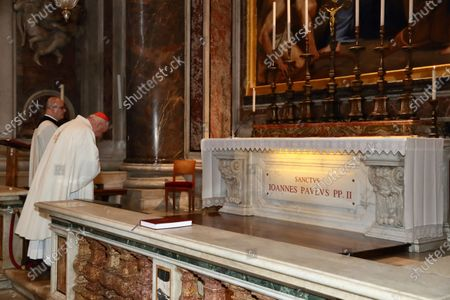 Stock Picture of Holy Mass celebrated by Cardinal Stanislaw Dziwisz, private secretary of Karol Wojtyla, at the tomb of St. John Paul II in the chapel of St. Sebastian on the feast of Our Lady of Fatima which 40 years ago saved the Polish Pope from an attack in St.