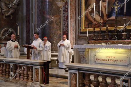 Stock Image of Holy Mass celebrated by Cardinal Stanislaw Dziwisz, private secretary of Karol Wojtyla, at the tomb of St. John Paul II in the chapel of St. Sebastian on the feast of Our Lady of Fatima which 40 years ago saved the Polish Pope from an attack in St.