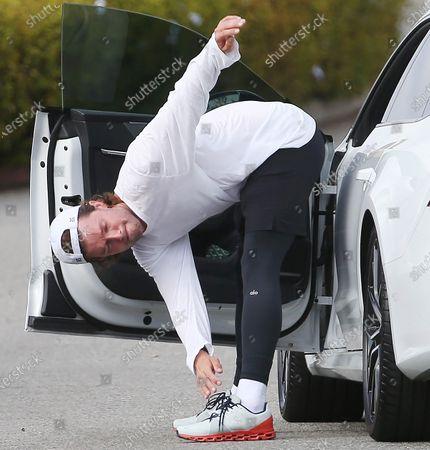 Patrick Schwarzenegger crushing stretching before going home