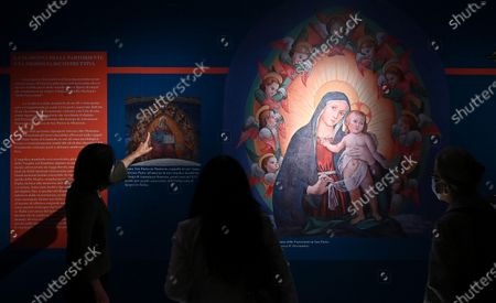 People look on a reconstructive hypothesis of the original fresco 'La Madonna delle Partorienti' by Antonino Romano during the presentation of the exhibition at Palazzo Madama, Turin,  Italy, 13 May 2021. For the first time since it was painted, at the end of the 15th century, 'La Madonna delle partorienti' comes out of the Sacred Grottoes of the Vatican, to be exhibited from 14 May to 20 July, after a long restoration, in the medieval court of Palazzo Madama in Turin.