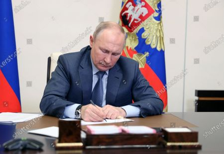 Stock Picture of Russian President Vladimir Putin chairs a meeting with the members of the government, via teleconference call, at Novo-Ogaryovo state residence, outside Moscow, Russia, 13 May 2021.
