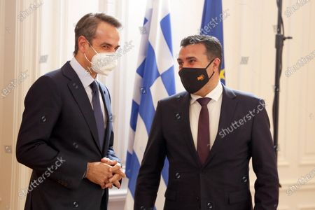 Stock Photo of Greek Prime Minister Kyriakos Mitsotakis (L) receives the Prime Minister of North Macedonia Zoran Zaev (R) during their meeting t the Maximos Palace, Athens, Greece, 13 May 2021.