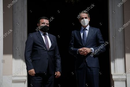 Greece's Prime Minister Kyriakos Mitsotakis (R) welcomes Prime Minister of North Macedonia Zoran Zaev (L), at the Maximos Mansion, after their meeting in Athens, Greece, 13 May 2021. Prime Minister of North Macedonia Zoran Zaev is in Athens to participate in the Delphi Economic Forum VI, held under the auspices of the Greek president.