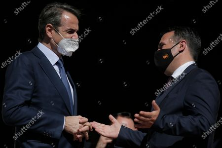 Greece's Prime Minister Kyriakos Mitsotakis (L) chats with Prime Minister of North Macedonia Zoran Zaev (R), at the Maximos Mansion, after their meeting in Athens, Greece, 13 May 2021. Prime Minister of North Macedonia Zoran Zaev is in Athens to participate in the Delphi Economic Forum VI, held under the auspices of the Greek president.