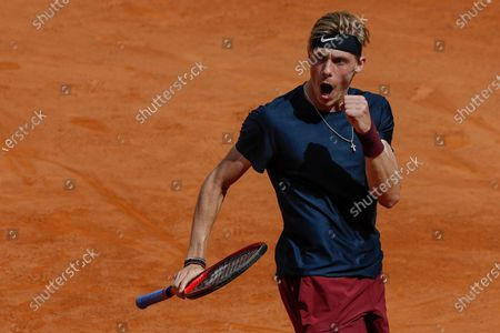 Canada's Denis Shapovalov celebrates winning a point to Spain's Rafael Nadal during their 3rd round match at the Italian Open tennis tournament, in Rome