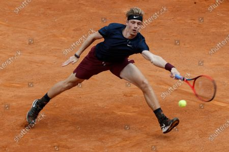 Canada's Denis Shapovalov returns the ball to Spain's Rafael Nadal, during their 3rd round match at the Italian Open tennis tournament, in Rome