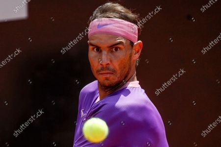Spain's Rafael Nadal prepares to return a ball to Canada's Denis Shapovalov, during their 3rd round match at the Italian Open tennis tournament, in Rome