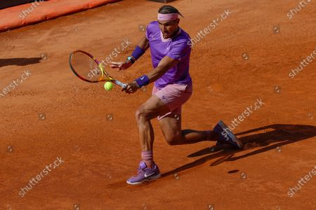 Stock Photo of Spain's Rafael Nadal looks returns the ball to Canada's Denis Shapovalov, during their 3rd round match at the Italian Open tennis tournament, in Rome