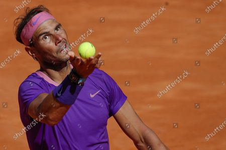 Spain's Rafael Nadal looks serves the ball to Canada's Denis Shapovalov, during their 3rd round match at the Italian Open tennis tournament, in Rome