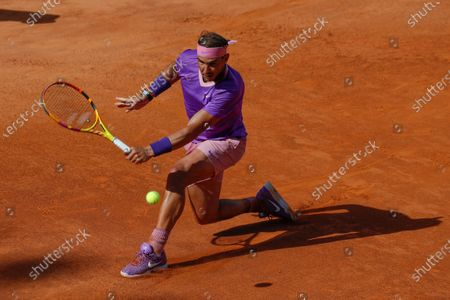 Stock Picture of Spain's Rafael Nadal returns the ball to Canada's Denis Shapovalov, during their 3rd round match at the Italian Open tennis tournament, in Rome