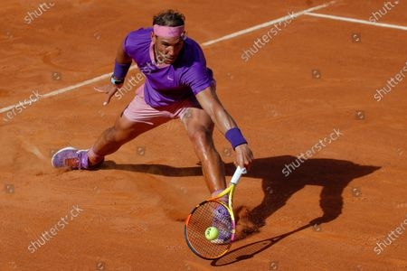 Stock Image of Spain's Rafael Nadal returns the ball to Canada's Denis Shapovalov, during their 3rd round match at the Italian Open tennis tournament, in Rome