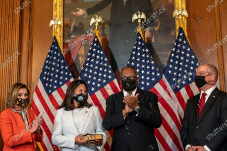 Stock Image of Speaker of the House Nancy Pelosi D-Ca., holds a ceremonial swearing in for Congressman Troy Carter D-La.,   as his wife Melanie holds a bible at the US Capitol in Washington, DC on Tuesday, May 11 2021.     Photo by Tasos Katopodis/UPI