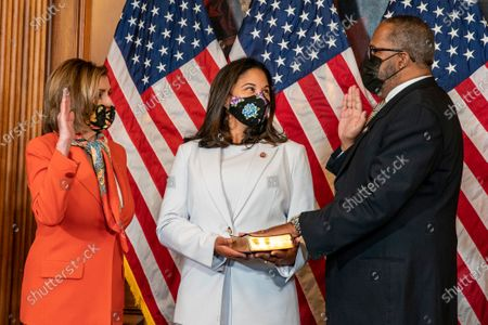 Speaker of the House Nancy Pelosi D-Ca., holds a ceremonial swearing in for Congressman Troy Carter D-La.,   as his wife Melanie holds a bible at the US Capitol in Washington, DC on Tuesday, May 11 2021.     Photo by Tasos Katopodis/UPI
