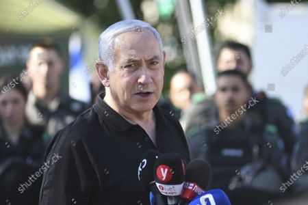 Israeli Prime Minister Benjamin Netanyahu meets with Israeli border police on in Lod, near Tel Aviv after a wave of violence in the city the night before. Jewish and Arab mobs battled in the central city of Lod, the epicenter of the troubles, despite a state of emergency and nighttime curfew