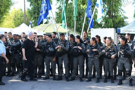 Stock Photo of Israeli Prime Minister Benjamin Netanyahu (L) greets as he meets with Israeli border police, after a wave of violence in the city between Arab and Jewish in the Israeli city of Lod, near Tel Aviv, Israel, 13 May 2021.