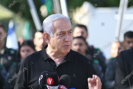 Stock Picture of Israeli Prime Minister Benjamin Netanyahu delivers a speech as he meets with Israeli border police, after a wave of violence in the city between Arab and Jewish in the Israeli city of Lod, near Tel Aviv, Israel, 13 May 2021.