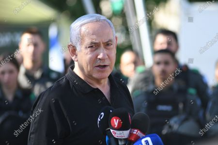 Israeli Prime Minister Benjamin Netanyahu delivers a speech as he meets with Israeli border police, after a wave of violence in the city between Arab and Jewish in the Israeli city of Lod, near Tel Aviv, Israel, 13 May 2021.