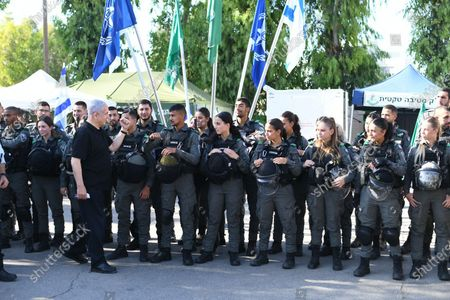 Israeli Prime Minister Benjamin Netanyahu (L) greets as he meets with Israeli border police, after a wave of violence in the city between Arab and Jewish in the Israeli city of Lod, near Tel Aviv, Israel, 13 May 2021.