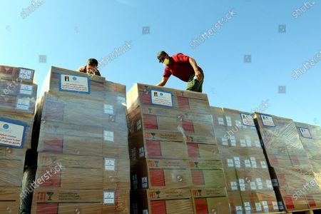 (210513) - ZARQA, May 13, 2021 (Xinhua) - Workers load the medical aid for Palestinians at the Jordan Hashemite Charity Organization's warehouse in Zarqa Governorate, Jordan, on May 13, 2021. King Abdullah II of Jordan on Wednesday ordered the government to send urgent medical aid to the Palestinians in the West Bank and the Gaza Strip, according to a Royal Court statement.