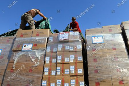Stock Image of (210513) - ZARQA, May 13, 2021 (Xinhua) - Workers load the medical aid for Palestinians at the Jordan Hashemite Charity Organization's warehouse in Zarqa Governorate, Jordan, on May 13, 2021. King Abdullah II of Jordan on Wednesday ordered the government to send urgent medical aid to the Palestinians in the West Bank and the Gaza Strip, according to a Royal Court statement.