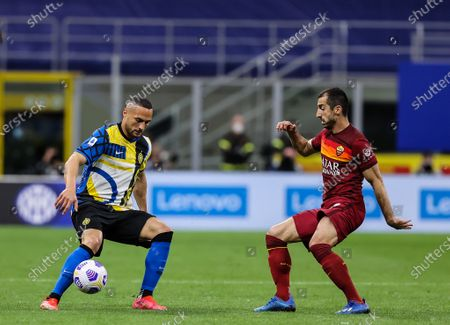 Danilo D'Ambrosio of FC Internazionale in action against Henrikh Mkhitaryan of AS Roma during the Serie A 2020/21 football match between FC Internazionale and AS Roma at Giuseppe Meazza Stadium. (Final score; FC Internazionale 3 - 1 AS Roma)
