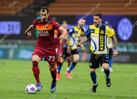 Henrikh Mkhitaryan of AS Roma and Stefano Sensi of FC Internazionale in action during the Serie A 2020/21 football match between FC Internazionale and AS Roma at Giuseppe Meazza Stadium. (Final score; FC Internazionale 3 - 1 AS Roma)