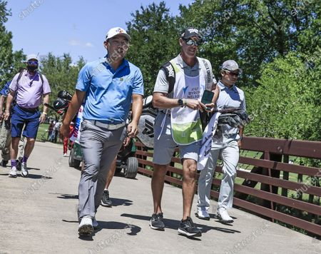 Sung Kang of South Korea (L) and Hideki Matsuyama of Japan (R) walks across a foot bridge on their way to the ninth fairway during the first round of the AT&T Byron Nelson golf tournament at TPC Craig Ranch in McKinney, Texas, USA, 13 May 2021. The tournament is being played 13 May through 16 May.