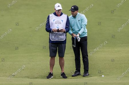 Sergio Garcia of Spain (R) confers with caddie Glen Murray (L) before hitting his second shot on the sixteenth hole during the first round of the AT&T Byron Nelson golf tournament at TPC Craig Ranch in McKinney, Texas, USA, 13 May 2021. The tournament is being played 13 May through 16 May.
