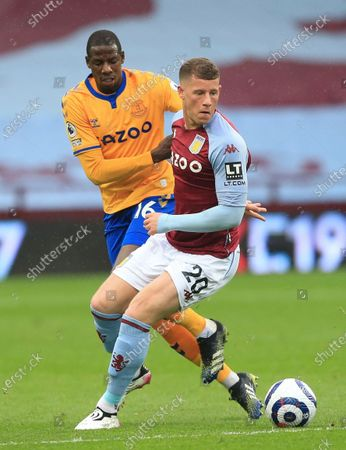 Stock Photo of Aston Villa's Ross Barkley, right, and Everton's Abdoulaye Doucoure challenge for the ball during the English Premier League soccer match between Aston Villa and Everton at Villa Park in Birmingham, England