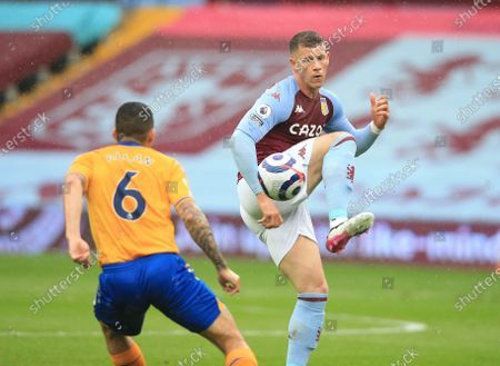 Aston Villa's Ross Barkley, right, and Everton's Allan challenge for the ball during the English Premier League soccer match between Aston Villa and Everton at Villa Park in Birmingham, England