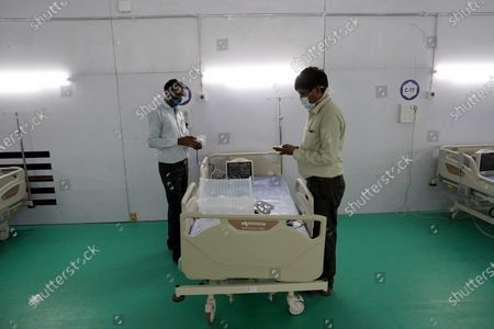 Medical workers install monitoring equipment's at the site of a temporary COVID-19 care facility, amidst the rising number of the coronavirus cases, at Ramlila grounds, in New Delhi, India on May 13, 2021. India's daily case count of Covid-19 went past the 3.5 lakh mark on Thursday after a two-day low even as the country recorded more than 4,000 deaths for the second day in a row.