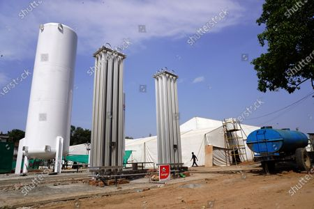 Stock Picture of A newly installed oxygen tank at the site of a temporary COVID-19 care facility, amidst the rising number of the coronavirus cases, at Ramlila grounds, in New Delhi, India on May 13, 2021. India's daily case count of Covid-19 went past the 3.5 lakh mark on Thursday after a two-day low even as the country recorded more than 4,000 deaths for the second day in a row.