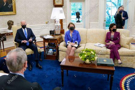 President Joe Biden speaks during a meeting in the Oval Office of the White House, in Washington. From left, Sen. Mike Crapo, R-Idaho, Biden, Sen. Shelley Moore Capito, R-W.Va., and Commerce Secretary Gina Raimondo