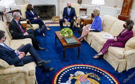 President Joe Biden speaks during a meeting in the Oval Office of the White House, in Washington. From left, Secretary of Transportation Secretary Pete Buttigieg, Sen. Mike Crapo, R-Idaho, Vice President Kamala Harris, Biden, Sen. Shelley Moore Capito, R-W.Va., and Commerce Secretary Gina Raimondo