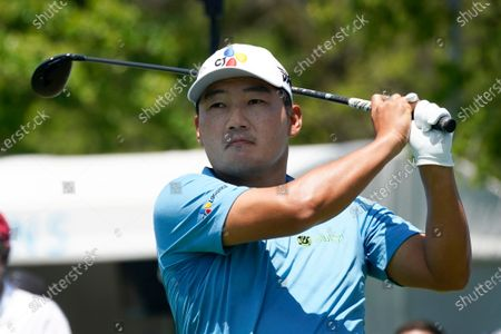 Sung Kang, of South Korea, watches his shot off the tee on the first hole during the first round of the AT&T Byron Nelson golf tournament, in McKinney, Texas
