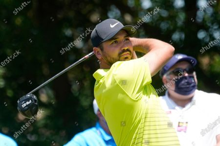 Jason Day, of Australia, watches his tee shot on the second hole during the first round of the AT&T Byron Nelson golf tournament, in McKinney, Texas
