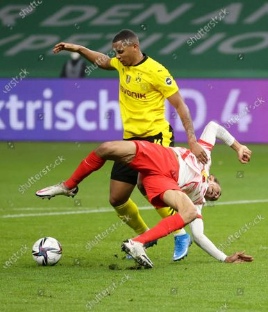 Dortmund's Manuel Akanji, left, and Leipzig's Yussuf Poulsen challenge for the ball during the German soccer cup (DFB Pokal) final match between RB Leipzig and Borussia Dortmund in Berlin, Germany